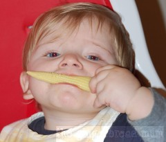 Nicholas eating baby corn