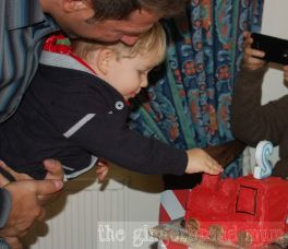 happy customer with his train cake